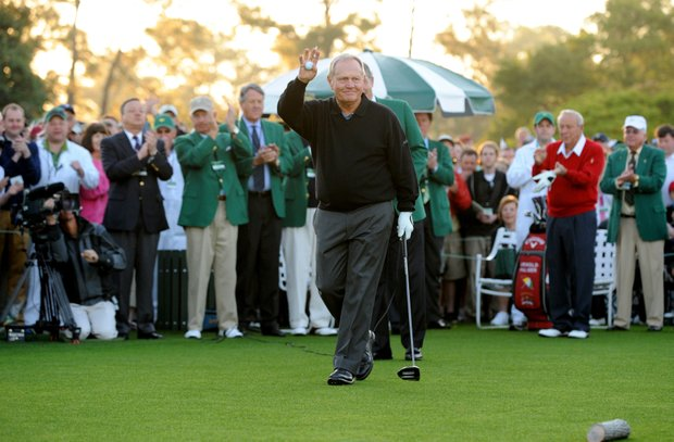 Legendary golfer Jack Nicklaus waves to the gallery before hitting his ceremonial tee shot during the first round of the Masters golf tournament at Augusta National Golf Club on April 7, 2011 in Augusta, Georgia.