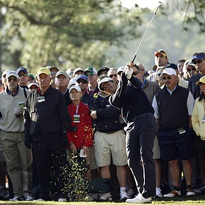 Adam Scott of Australia watches his shot out of the rough off the first fairway during the first round of the Masters golf tournament Thursday, April 7, 2011, in Augusta, Ga.