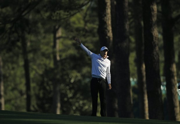 Nick Watney yells to the gallery after a shot hit by Adam Scott of Australia during the first round of the Masters golf tournament Thursday, April 7, 2011, in Augusta, Ga.