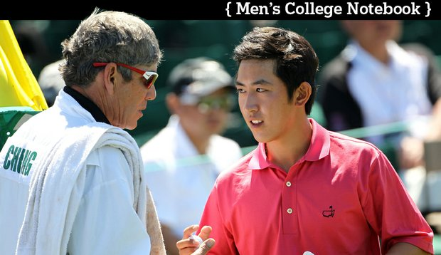 Stanford's David Chung shakes hands with his caddie and coach Adam Schriber on the 18th green during the first round of the 2011 Masters.