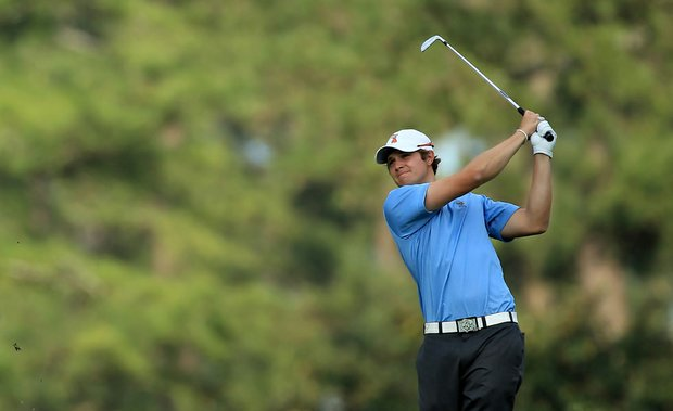 Peter Uihlein hits his second shot on the 14th hole during the first round of the 2011 Masters.