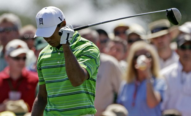Tiger Woods opened with 1-under 71 at Augusta.