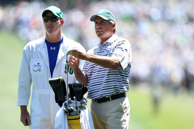 Fred Couples talks with his caddie Joe LaCava on the first hole during the first round of the 2011 Masters Tournament. LaCava has also worked for Dustin Johnson and will reportedly move to Tiger Woods' bag.