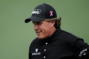 Phil Mickelson walks across the second green during the second round of the 2011 Masters Tournament at Augusta National Golf Club on April 8, 2011 in Augusta, Georgia.