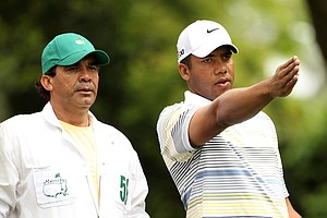 Jhonattan Vegas of Venezuela talks with his caddie on the second hole during the second round of the 2011 Masters Tournament at Augusta National Golf Club on April 8, 2011 in Augusta, Georgia.