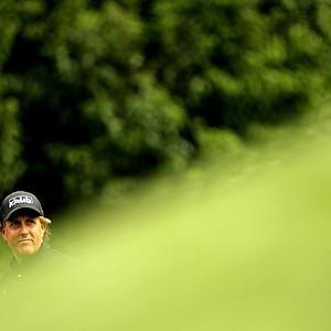 Phil Mickelson walks off the fourth tee during the second round of the 2011 Masters Tournament at Augusta National Golf Club on April 8, 2011 in Augusta, Georgia.