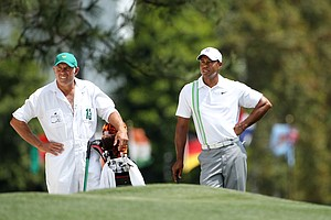 Tiger Woods waits with his caddie Steve Williams on the first hole during the second round of the 2011 Masters Tournament at Augusta National Golf Club on April 8, 2011 in Augusta, Georgia.