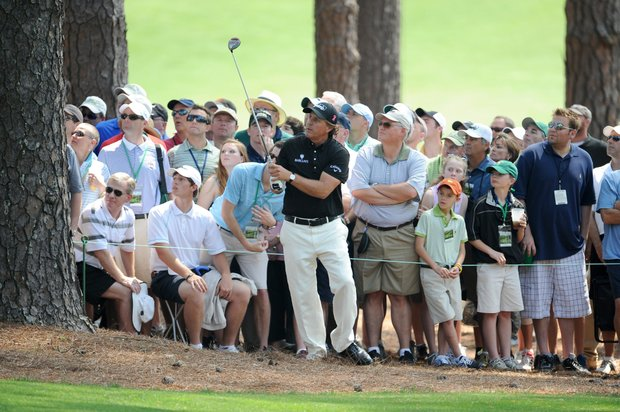Phil Mickelson of the US watches his ball after hitting from the rough on the 8th hole during second round of the Masters golf tournament at Augusta National Golf Club on April 8, 2011 in Augusta, Georgia.