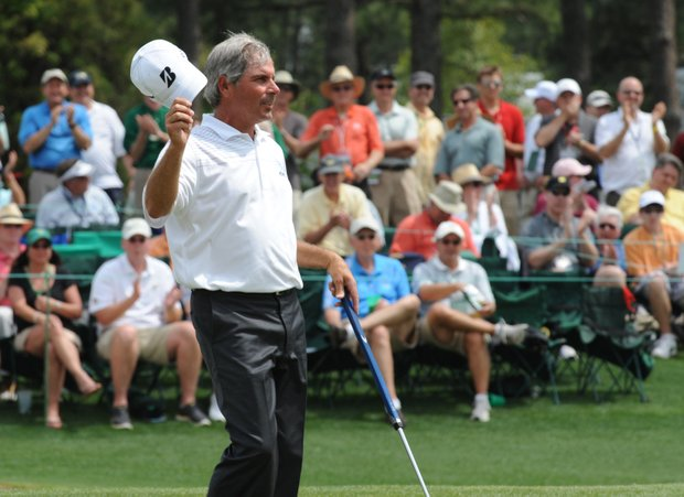 Fred Couples of the US finishes at the 18th hole during second round of the Masters golf tournament at Augusta National Golf Club on April 8, 2011 in Augusta, Georgia