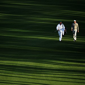 Charl Schwartzel of South Africa and caddie Greg Hearmon walk up the second hole fairway during the second round of the 2011 Masters Tournament at Augusta National Golf Club on April 8, 2011 in Augusta, Georgia.