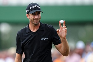 Geoff Ogilvy waves to the crowd on the 17th green during the second round of the 2011 Masters.