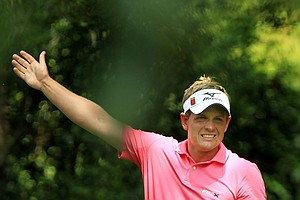 Luke Donald watches his tee shot on the second hole during the third round of the 2011 Masters.