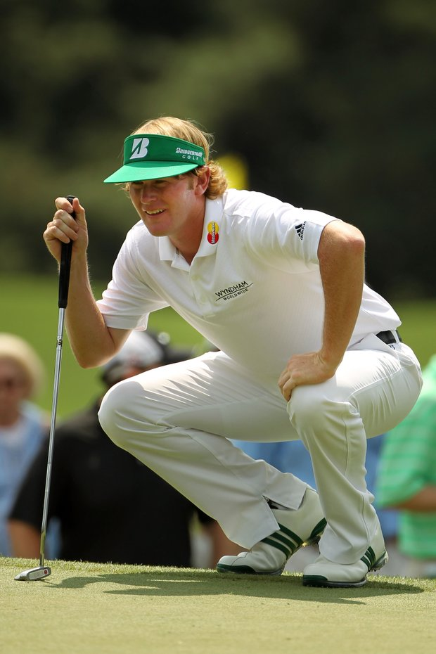 Brandt Snedeker lines up a putt on the first green during the third round of the 2011 Masters.