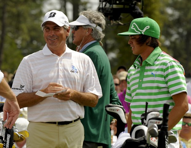 Fred Couples, left, and Rickie Fowler arrive at the first hole during the third round of the 2011 Masters.