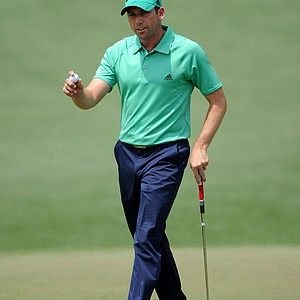 Sergio Garcia walks across the second green during the third round of the 2011 Masters.