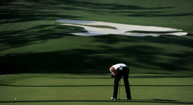 Rory McIlroy reacts to a missed putt on the tenth green during the third round of the 2011 Masters.