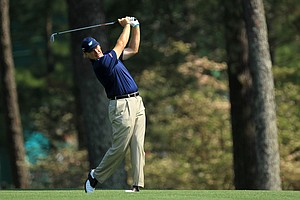 Ernie Els of South Africa watches his second shot on the second hole during the third round of the 2011 Masters Tournament at Augusta National Golf Club on April 9, 2011 in Augusta, Georgia.