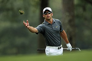 Paul Casey of England tosses a divot on the first hole fairway during the third round of the 2011 Masters Tournament at Augusta National Golf Club on April 9, 2011 in Augusta, Georgia.
