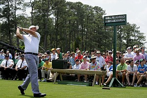 Phil Mickelson of the US hits his tee shot on the first hole during the third round of the Masters golf tournament at Augusta National Golf Club on April 9, 2011 in Augusta, Georgia.