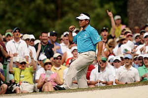 K.J. Choi of South Korea reacts to saving par on the seventh hole during the third round of the 2011 Masters Tournament at Augusta National Golf Club on April 9, 2011 in Augusta, Georgia.