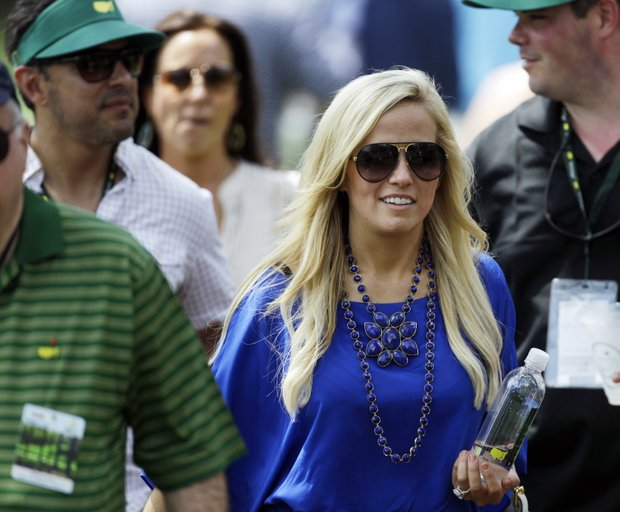Phil Mickelson's wife Amy walks with spectators down the 14th hole during the second round of the Masters golf tournament Friday, April 8, 2011, in Augusta, Ga.