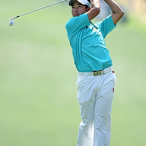 Amateur Hideki Matsuyama of Japan watches a shot on the first hole during the third round of the 2011 Masters Tournament at Augusta National Golf Club on April 9, 2011 in Augusta, Georgia.