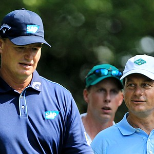 Ernie Els of South Africa walks with Jeff Knox, playing as a non-competing marker, on the second hole during the third round of the 2011 Masters Tournament at Augusta National Golf Club on April 9, 2011 in Augusta, Georgia.
