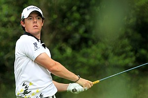 Rory McIlroy watches his tee shot on No. 2 at Augusta.