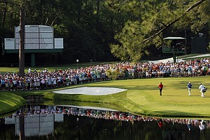 Tiger Woods walks with his caddie Steve Williams and Martin Laird to the 16th green during the final round of the 2011 Masters.