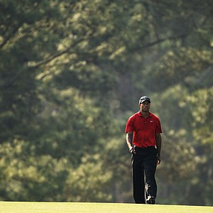 Tiger Woods walks up the 17th fairway during the final round of the 2011 Masters.