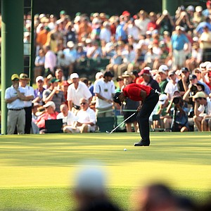 Tiger Woods reacts to a missed eagle putt on the 15th hole during the final round of the 2011 Masters.