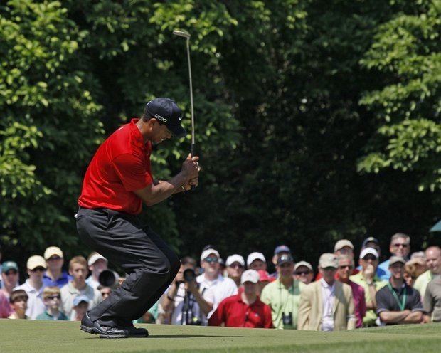 Tiger Woods reacts after missing a birdie on the first hole during the final round of the Masters golf tournament Sunday, April 10, 2011, in Augusta, Ga.