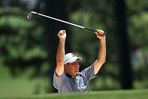 Fred Couples prepares to play a shot on the first hole during the final round of the 2011 Masters Tournament on April 10, 2011 in Augusta, Georgia.