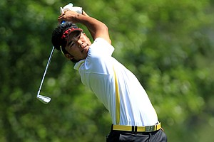 Amateur Hideki Matsuyama of Japan hits his tee shot on the fourth hole during the final round of the 2011 Masters Tournament on April 10, 2011 in Augusta, Georgia.