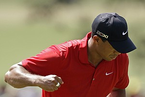 Tiger Woods reacts after his birdie on No. 7.