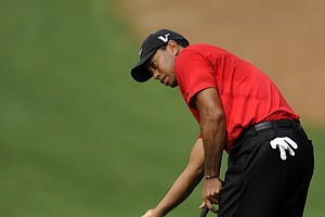 Tiger Woods reacts to his shot on the 10th hole during the final round of the Masters golf tournament at Augusta National Golf Club on April 10, 2011 in Augusta, Georgia.