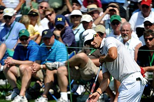Adam Scott of Australia putts on the 2nd hole during the final round of the Masters golf tournament at Augusta National Golf Club on April 10, 2011 in Augusta, Georgia.