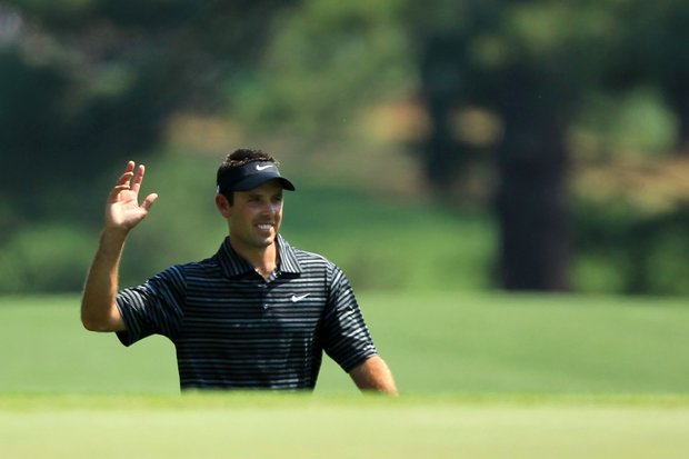Charl Schwartzel of South Africa waves to the gallery after holing a shot for eagle on the third green during the final round of the 2011 Masters Tournament on April 10, 2011 in Augusta, Georgia.