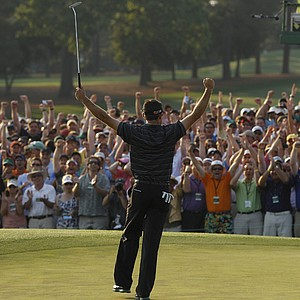 Charl Schwartzel of South Africa reacts after making a birdie putt on the 18th hole during the final round of the Masters golf tournament Sunday, April 10, 2011, in Augusta, Ga.