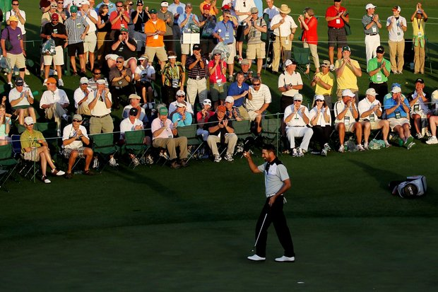 Alvaro Quiros of Spain waves to the patrons on the 18th hole during the first round of the 2011 Masters Tournament at Augusta National Golf Club on April 7, 2011 in Augusta, Georgia.