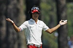 Ryo Ishikawa of Japan reacts after a shot on the second hole during the final round of the Masters golf tournament Sunday, April 10, 2011, in Augusta, Ga.