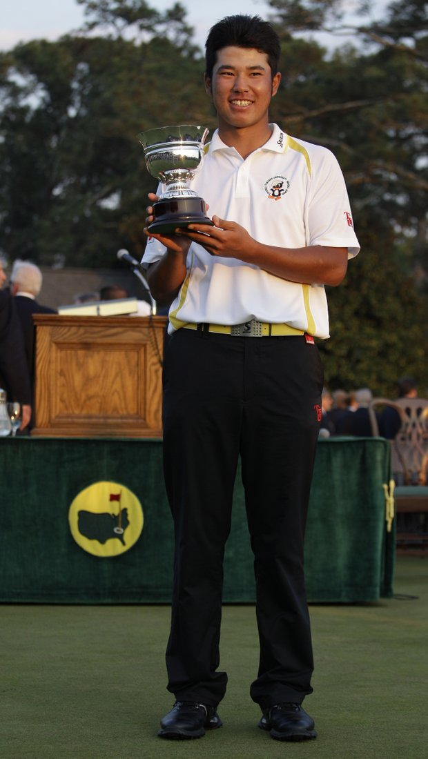 Hideki Matsuyama of Japan holds his trophy after winning the low amateur award at the 2011 Masters.