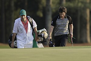 Rory McIlroy walks up the 18th fairway with his caddie J.P. Fitzgerald during the final round of the 2011 Masters.