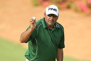 Angel Cabrera waves to the gallery on the tenth green during the final round of the 2011 Masters.