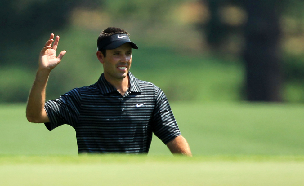 Charl Schwartzel waves to the gallery after holing a shot for eagle on the third green during the final round of the 2011 Masters.