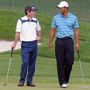 Mark Wilson, left, and Tiger Woods share a laugh while waiting to putt on the 18th green during the first round of the Arnold Palmer Invitational golf tournament in Orlando, Fla., Thursday, March 26, 2009.