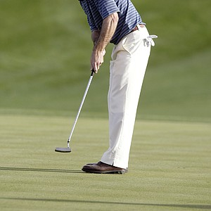 Mark Wilson watches his putt for birdie drop on the 18th green during the second round of the Phoenix Open PGA golf tournament Friday, Feb. 26, 2010, in Scottsdale, Ariz. Wilson finished the round at 11-under-par.