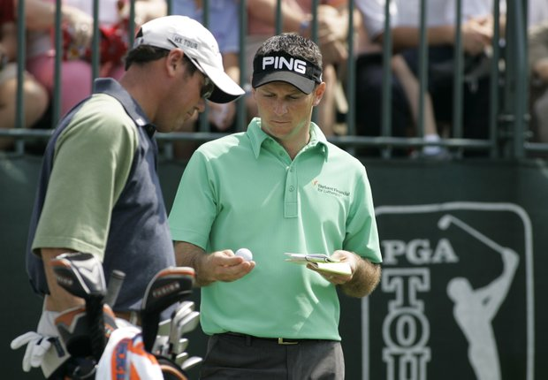 Mark Wilson, right, shows Rich Beem his ball markings before the two tee off on the first hole Saturday, March 4, 2006 during the third round of the Ford Championship at Doral in Doral, Fla.