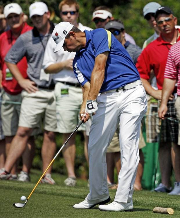 Gary Woodland hits a drive on the seventh hole during the second round of the Masters golf tournament Friday, April 8, 2011, in Augusta, Ga.