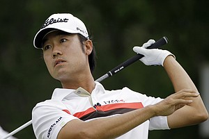 Kevin Na watches his second drive off the ninth tee during the first round of the Texas Open. Na hit four drives on the hole.